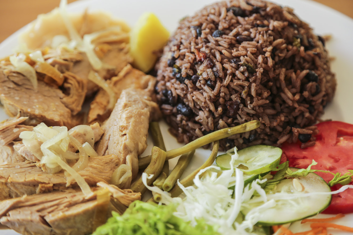 Roasted meat with rice and beans